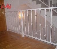 barandillas acero forjado en escalera